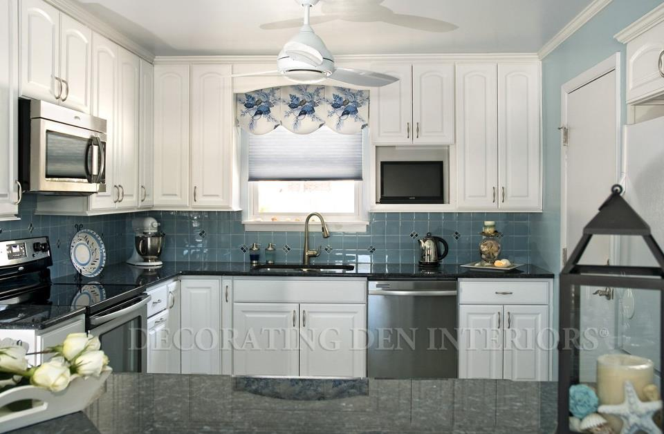 This coastal cottage kitchen features a classic color scheme, coastal