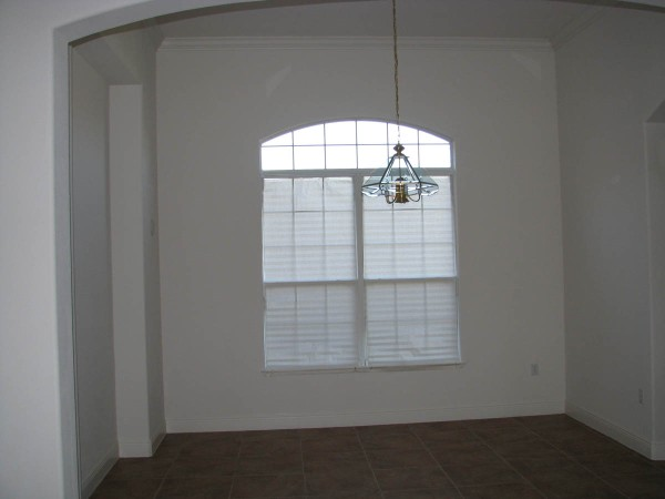 empty dining room with wall niche