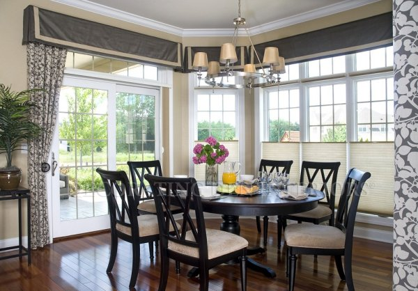 Contemporary Dining Room with wall of windows
